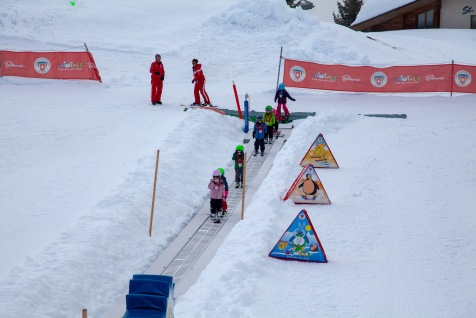 Toddlers taking ski lessons in Bettmeralp.
